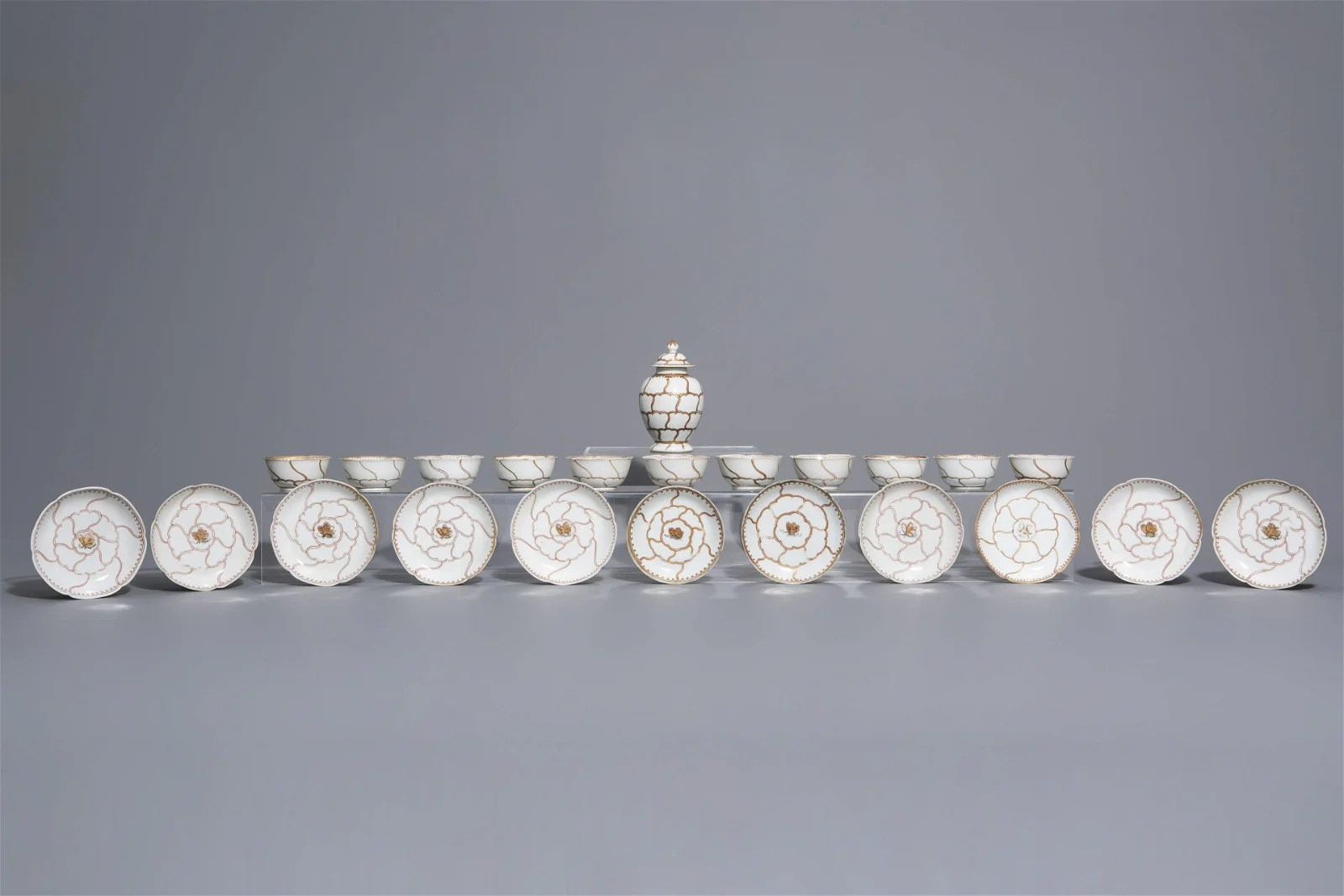 A Chinese 23-piece partly gilt tea set with a