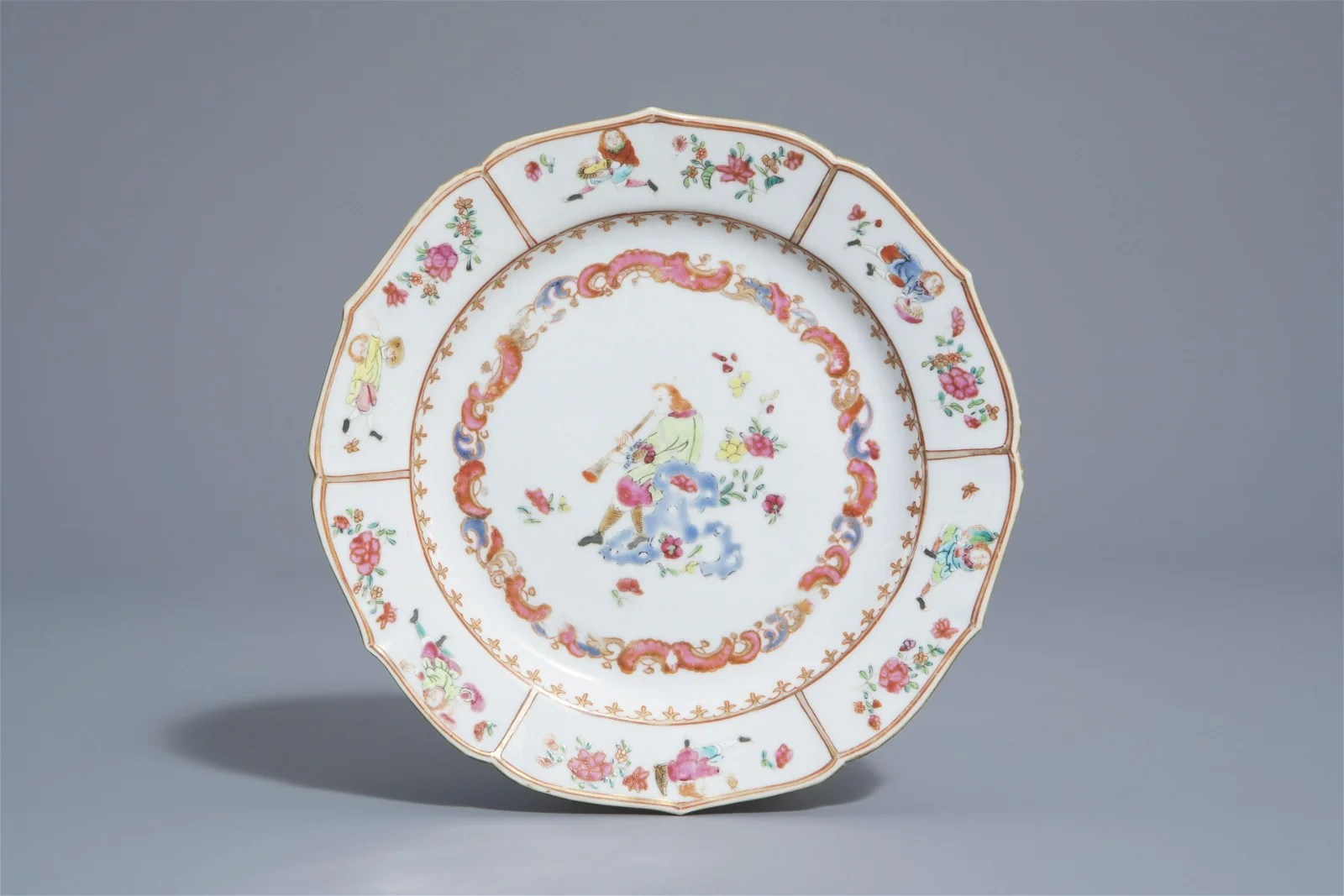 A Chinese famille rose plate with an European flute