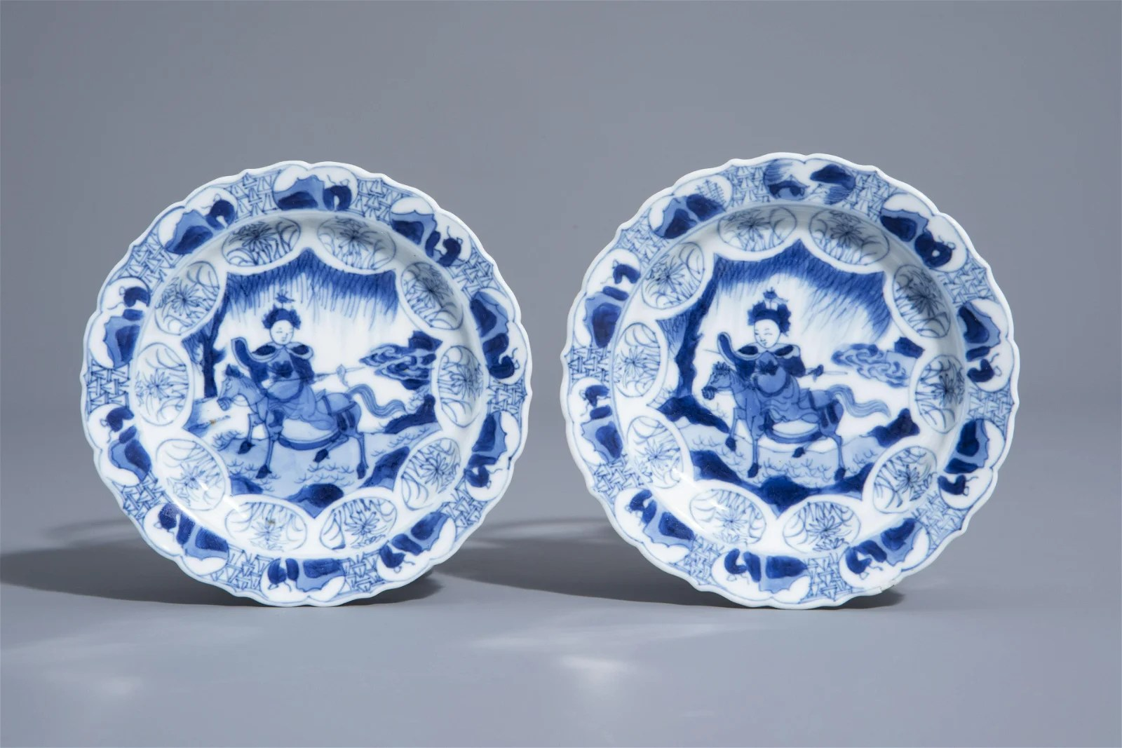 A pair of Chinese blue and white horserider saucers
