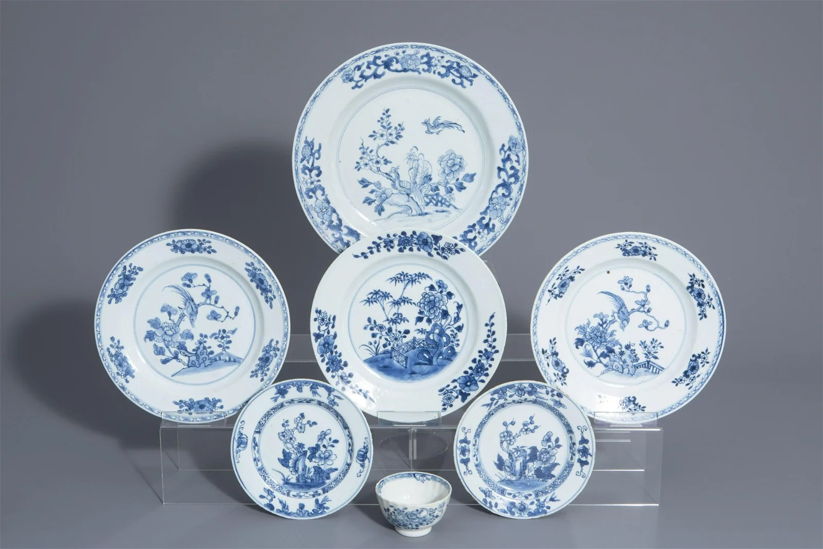 Six Chinese blue and white plates and a cup with floral