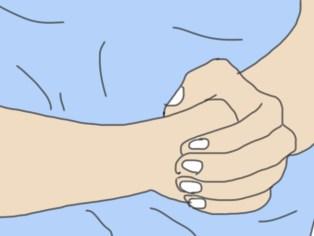 Position des mains Heimlich chez le chien