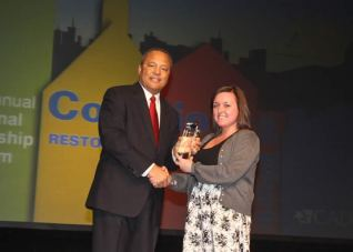 "Allana Chittick receives the ""Outstanding Youth Leadership Award"" for her work with P2D2"