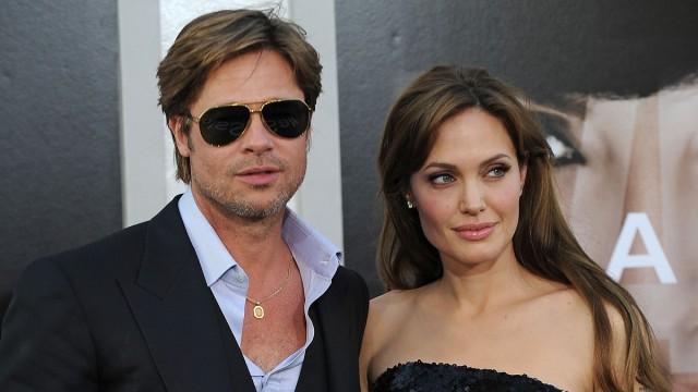 Evig kjekke Brad Pitt og humanitæraksjonen personifisert i Angelina Jolie. (Foto: AFP PHOTO / Robyn BECK)