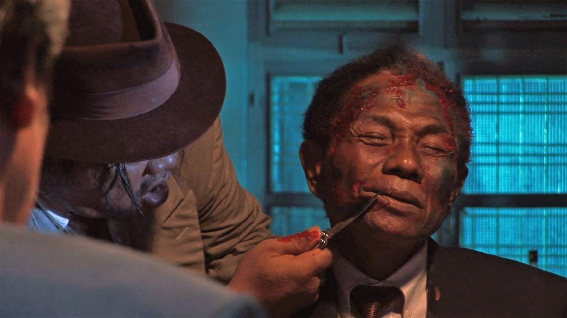 Anwar Congo spiller offer i en regissert scene i The Act of Killing (Foto: Tour de Force).