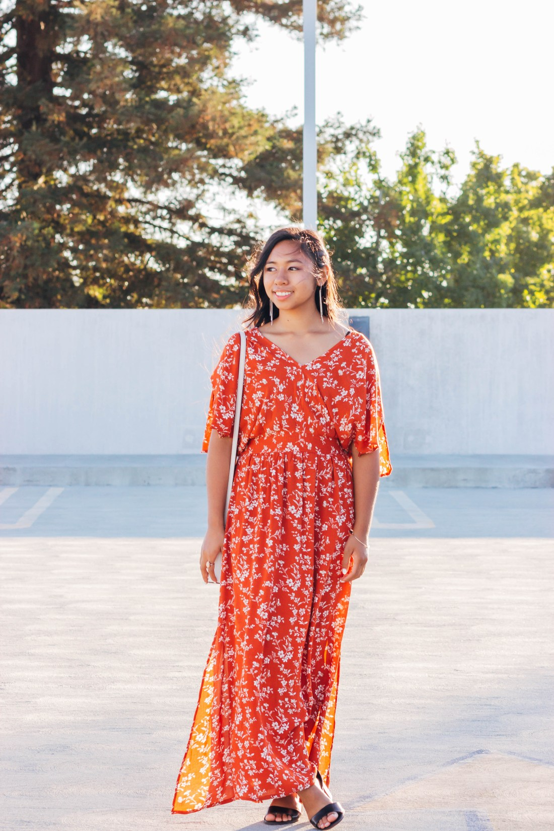 The perfect fall dress. Burnt orange, flower detail, tie back maxi dress with black heels.   In this post, Blaze Ann gives an honest life update, sharing where she's going to college, the last time she cried, etc.. on P31beauty.