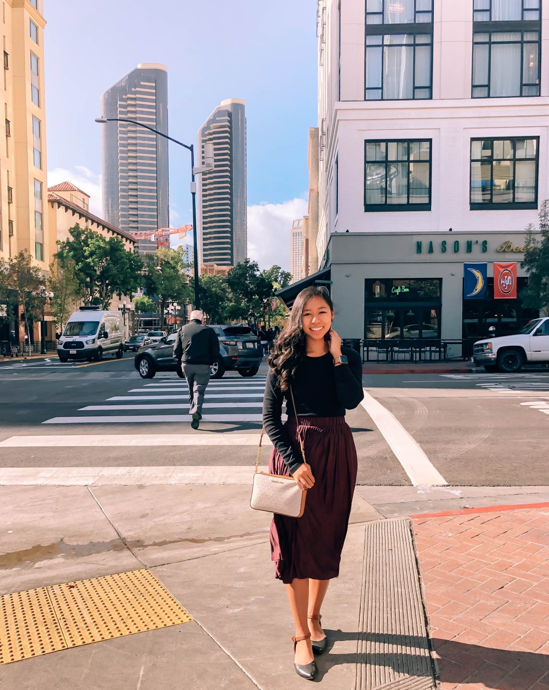 Holiday outfit with burgundy skirt and pointed flats