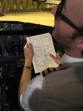 co-pilot with one of the checklists