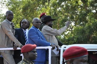 President Salva Kiir, Governor Paul Malong Awan (Blue suit) and Cabinet Affairs Minister Martin Lomuro (black suit) during the public rally in Aweil, NBeG