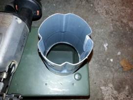 75 mm rørsamlemuffe anvendes som tilslutningsstuds. Denne fastsvejses på wood stove'en.
