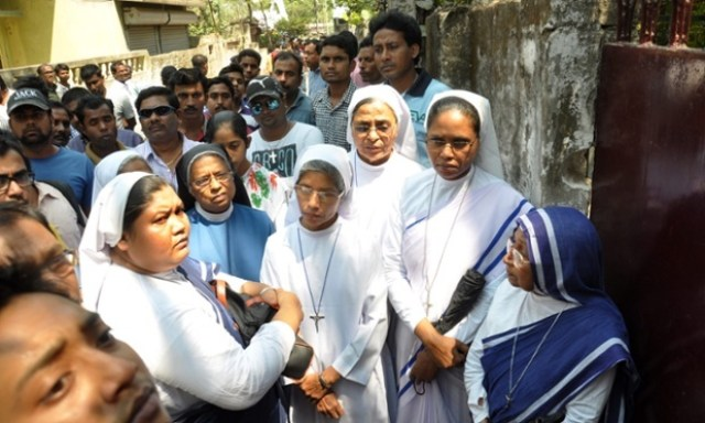 nuns-and-other-locals-in-front-of-a-convent-school-at-ranaghat-79km-north-of-kolkata-where-robbers-raped-an-elderly-nun