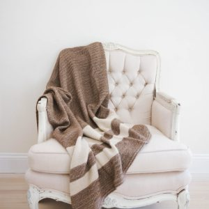 Get your Maine alpaca couch throw for this winter!  Makes a great gift! Your couch will thank you. Photography by Amanda Fogarty