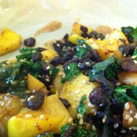Fried Apple and Wilted Kale Salad with Curried Raisins and Honey Mustard Vinaigrette