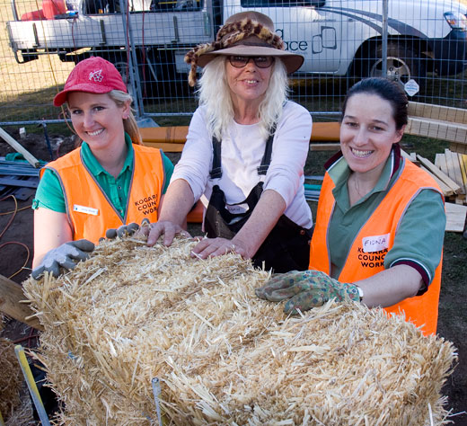 The first bale is placed at Carrs Park Community Garden's outdoor classroom.  (From left): Jenny Howie (Kogarah Council), Susan (Huff'N'Puff). Fiona stock (Kogarah council).