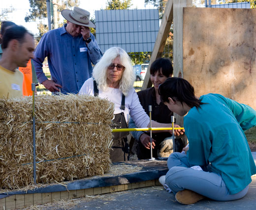 Huff'N'Puff's Susan makes a measurement to size a strawbale to fit.