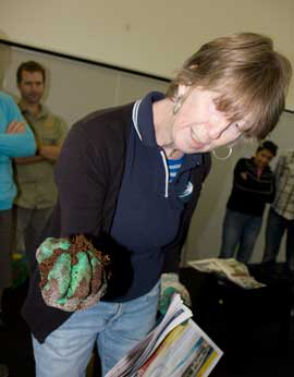 Fiona demonstrates the squeeze test to assess the moisture content of growing media in a wormery.