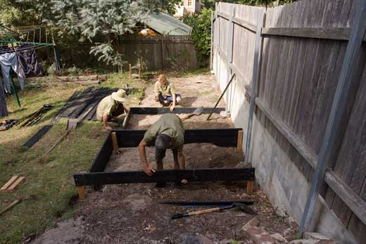 DAY ONE, morning: Construction is underway on the first of the raised beds, with Steve's apprentices working on the second bed behind. The apprentices had joined Steve's business only four days previously.