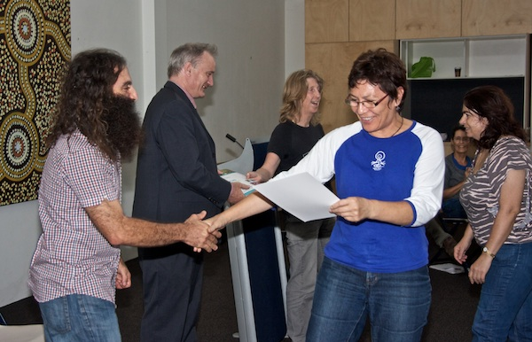 Randwick Mayor, Murray Matson (in suit) and Costa congratulate Living Smart and Sustainable Living course participants as they receive their certificates.