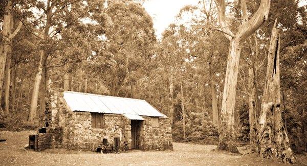 Three huts on a trail