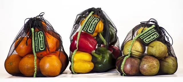grocery bags filled with apples and peppers for people quarantined due to coronavirus