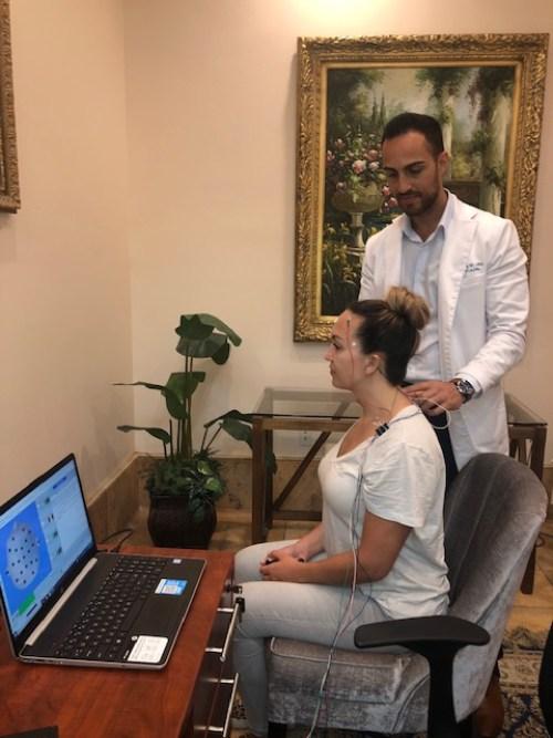 Pacific Pearl Patient receiving Micro Current neurofeedback