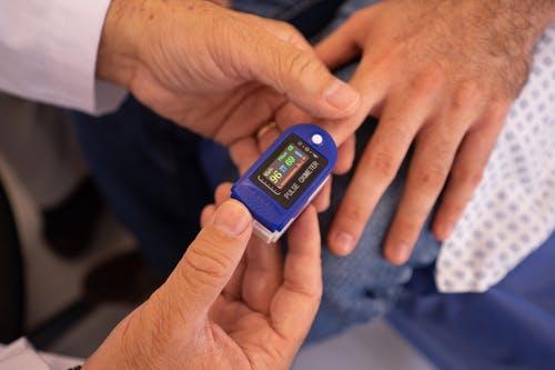 man getting pulse taken at Guarneri integrative health