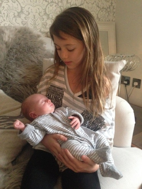 Our eldest daughter, aged 11, holding our friend's 4 week old baby.