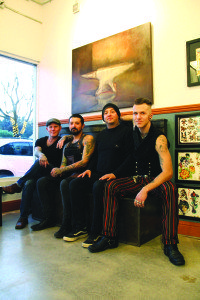 The artistic four, who merge their talents at The Forge Tattoo. Photo by Molly Oleson.