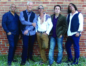 The CORE, a five-member band with a large repertoire, learns new songs all of the time to please their clients (Martinez is second from right). Photo courtesy of The CORE.