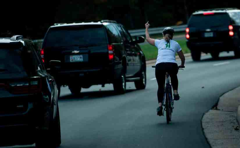 Virginia Woman Fired For Flipping Off President Trump's Motorcade