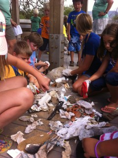 Ocean Camp students count the trash they collected during a recent beach cleanup