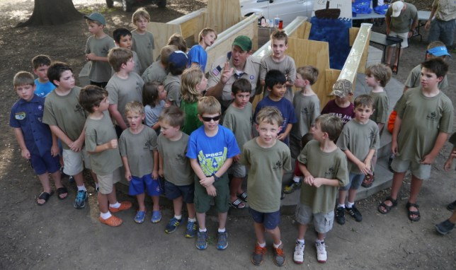 Our boys enjoying a song before our rain gutter regatta. (This is only 1/3 of our boys.)