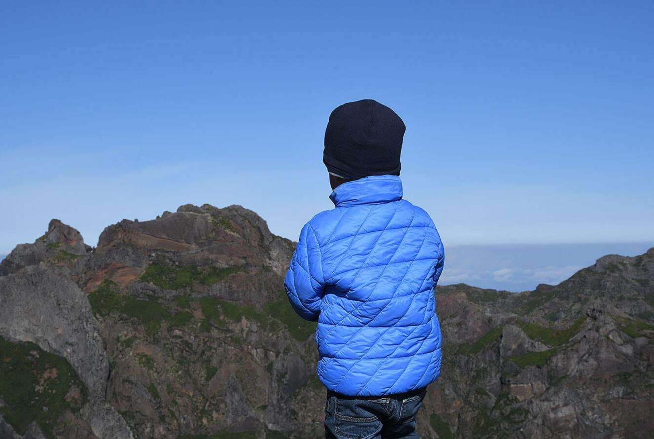 Taking in the view at Pico Arierio over the Volcanic mountains. Madeira - Portugal