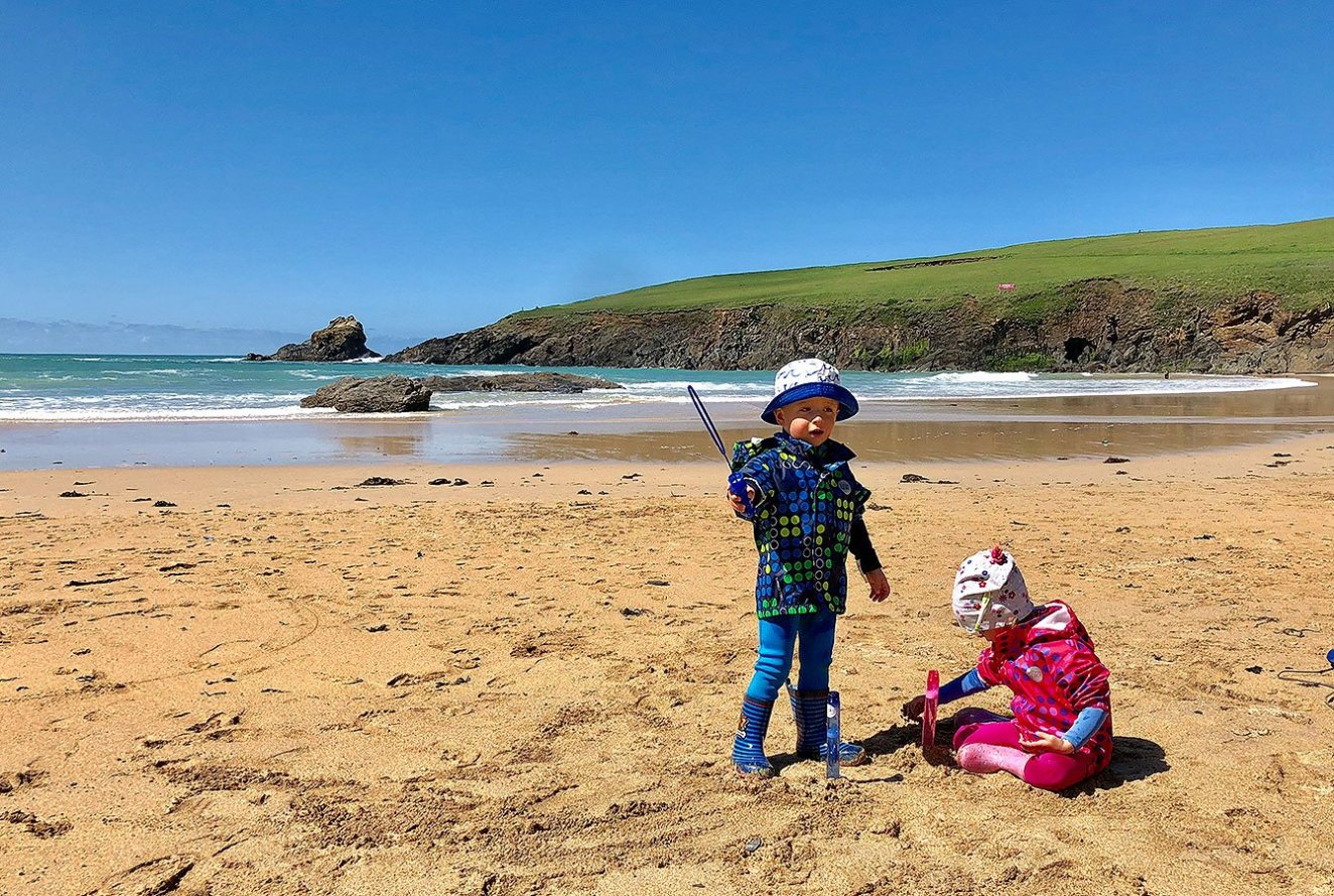 Trevone Beach, Enjoying the low tide whilst playing in the sand, Cornwall, Engalnd