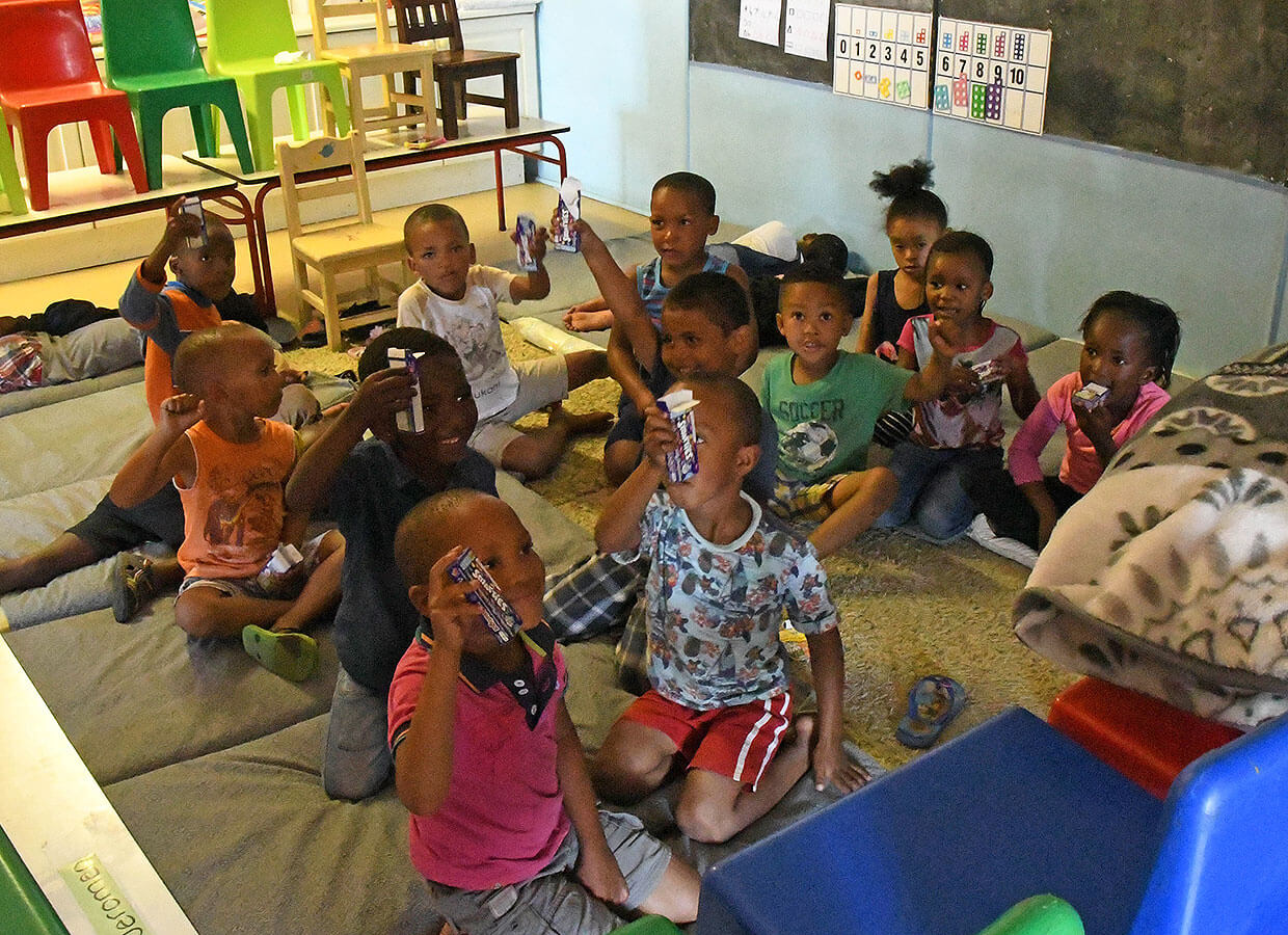 Children at the creche enjoying some sweets our kids wanted to give to them
