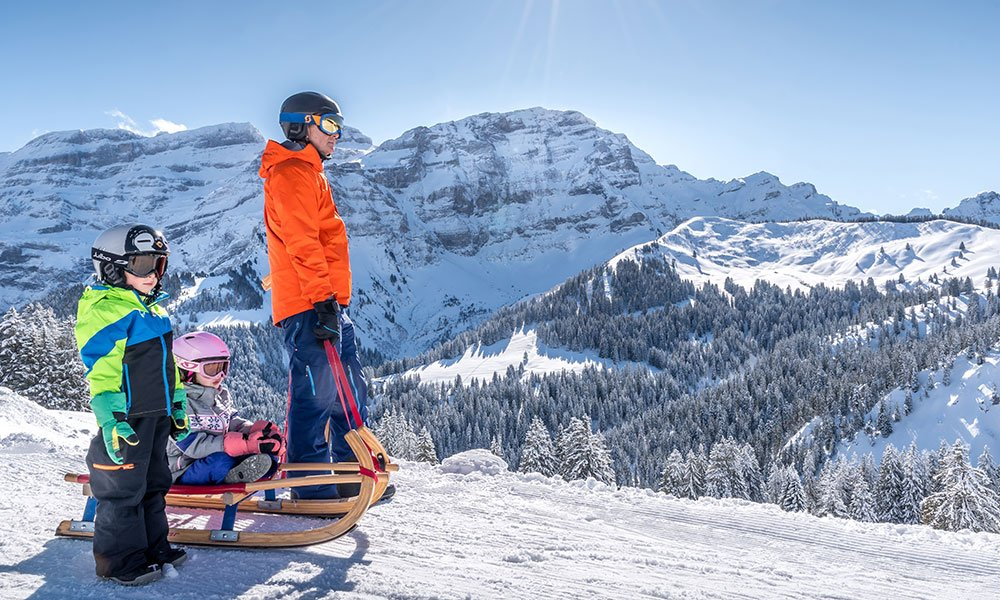 family sledging in Les Diablerets