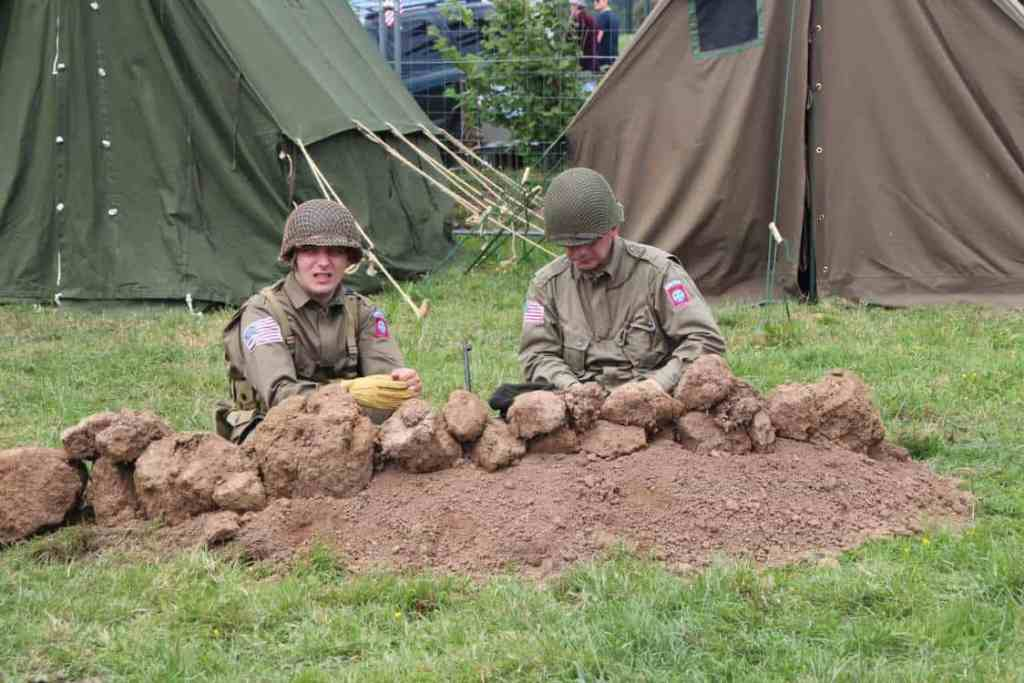 Huge model camp from WWII complete with tanks, vehicles, reenactors and tents.