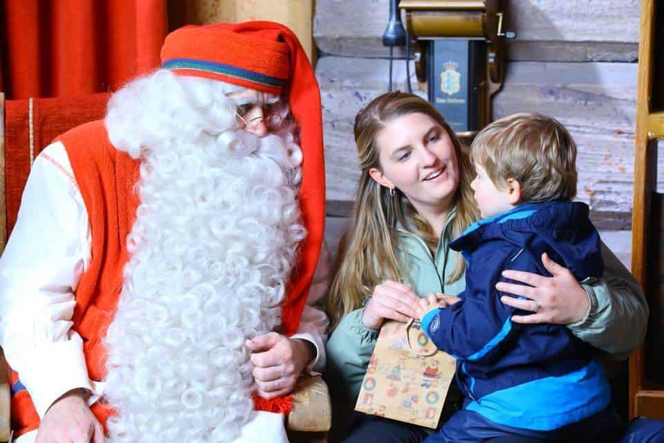 Santa giving a little boy a gift