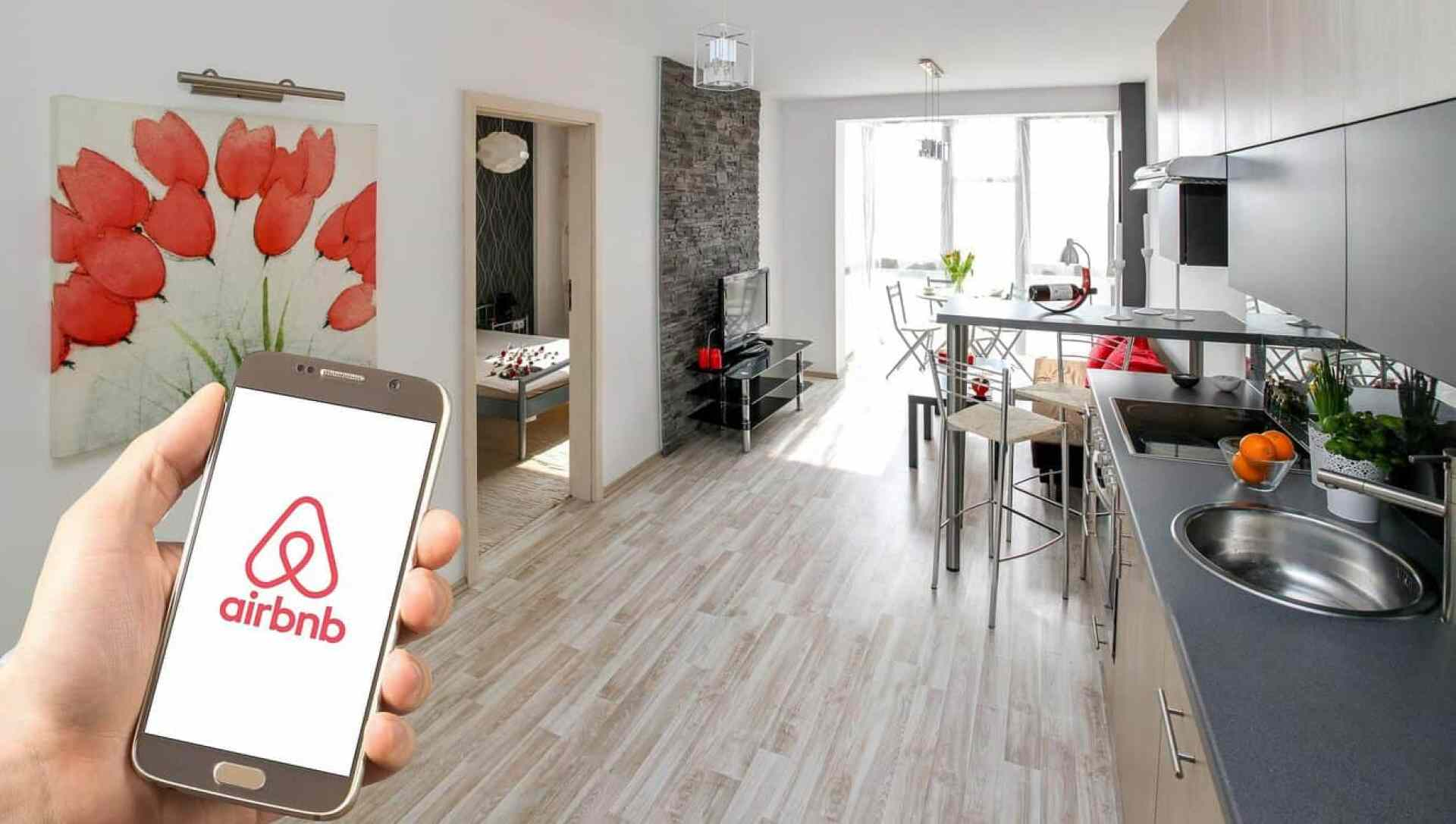 airbnb app on phone in an apartment
