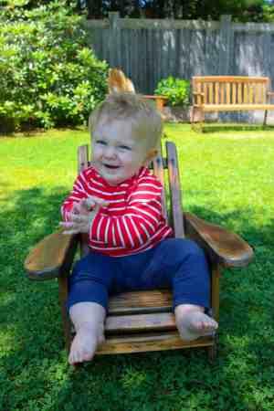 Baby sitting in a chair in thuya garden gardens acadia