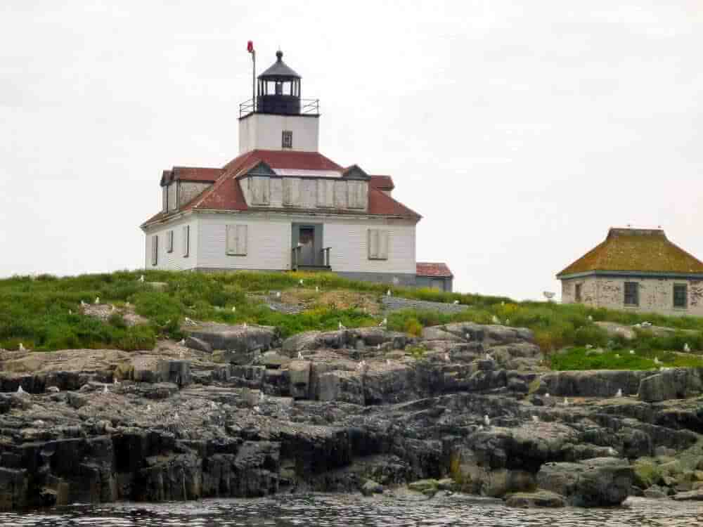 Egg Rock Lighthouse as seen from a lobster boat tour in bar harbor maine