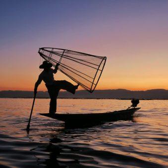 Fisherman posing in sunset