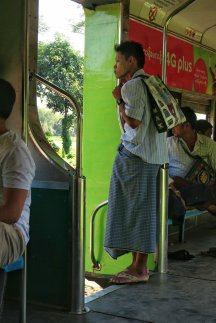 Boy in Yangon wearing tanaka and longyi