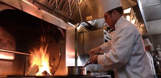 Chef Cooking on a Stove