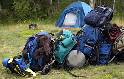 Pile of camping gear by tent