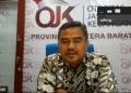 Kepala Perwakilan OJK Sumatera Barat Misran Pasaribu dalam pertemuan virtual dengan wartawan, memaparkan kinerja IJK dan peran OJK dalam PEN, Kamis (22/10/2020). (Febry)