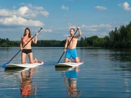 Beginner standup paddleboarders on knees