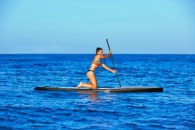 beginner standup paddleboard on knees paddling