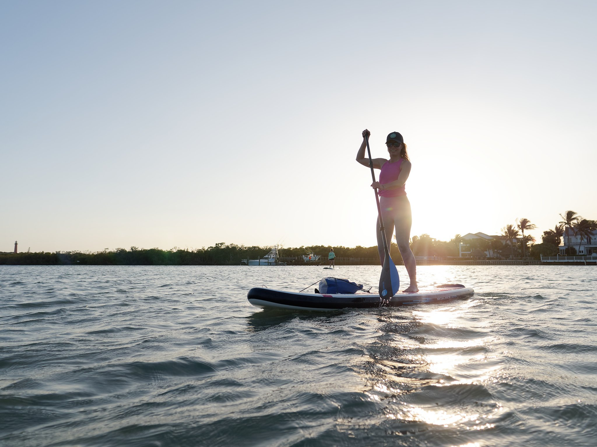 Woman learning how to a paddle board