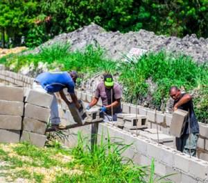 Local teams cement drains.