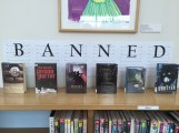 Close up of banned signage with books